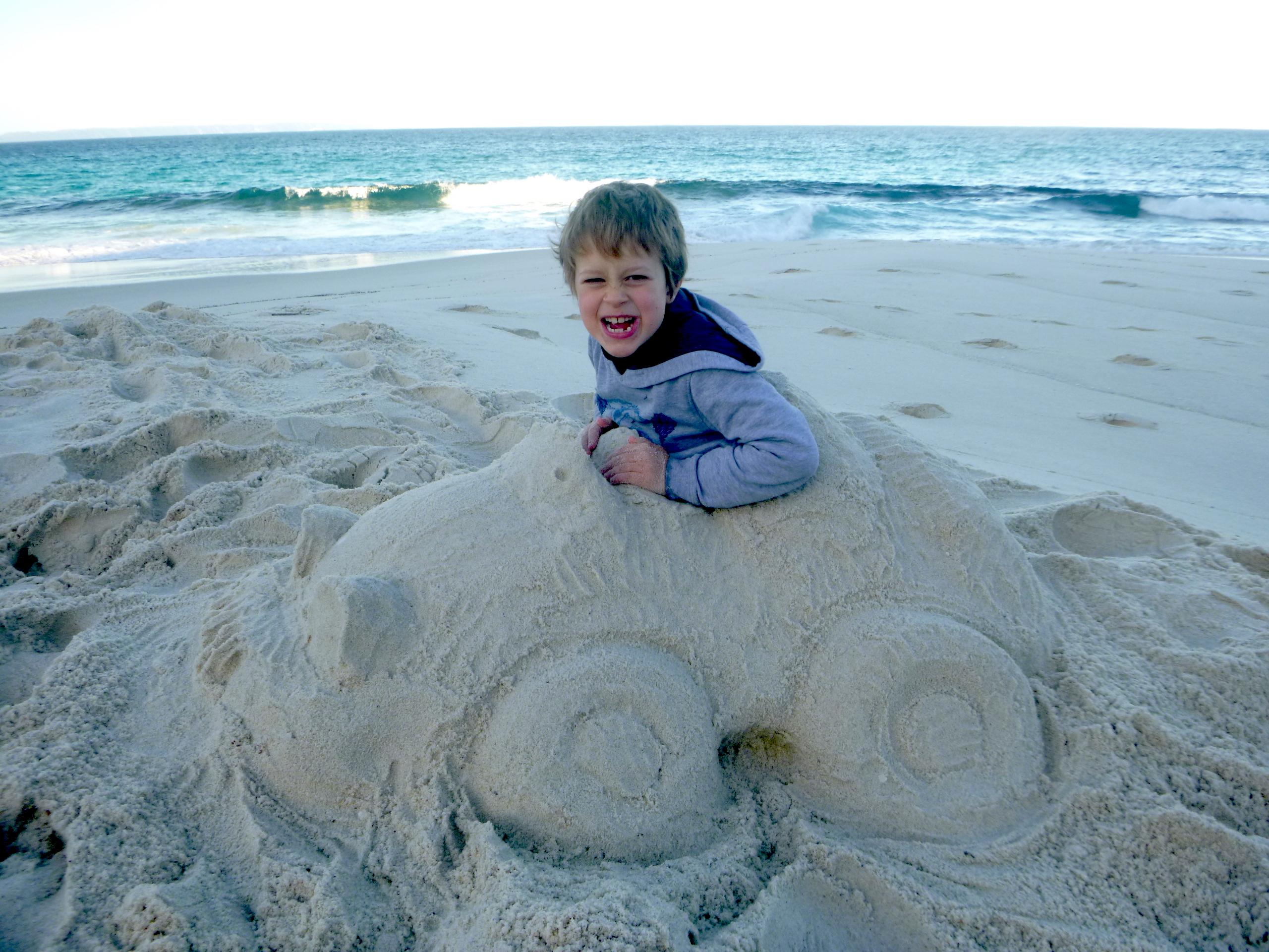 Child in sand car
